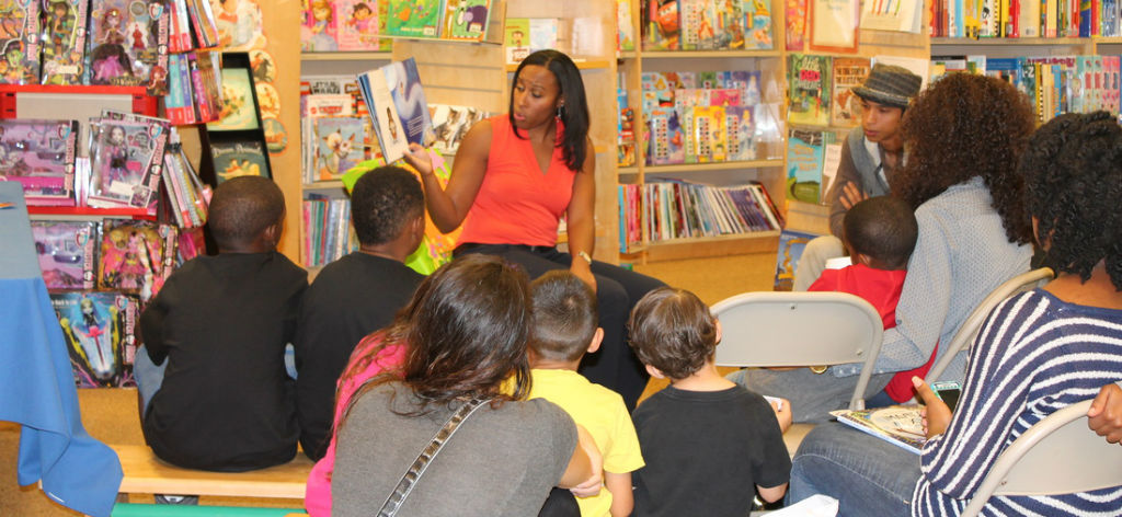 JaNay Reads to a group of kids