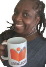 Author Jewel Caston-Mendoza Holding AALBC Mug