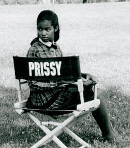 Sharp in her chair on location for the Gordan Parks' film, The Learning Tree""