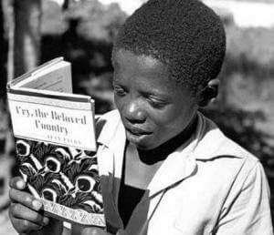 "A Boy Reading, ""Cry, the Beloved Country"" by Alan Paton"
