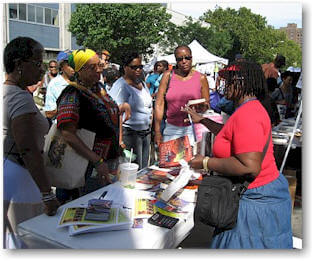 Mallette (red rhirt) speaks to fans and Harlem Book     Fair 2007