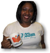 Author Monda Webb with an AALBC.com Coffee Mug
