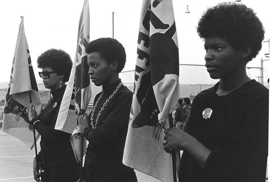 Women holding Black Panther flags. Courtesy of Pirkle Jones and Ruth-Marion Baruch